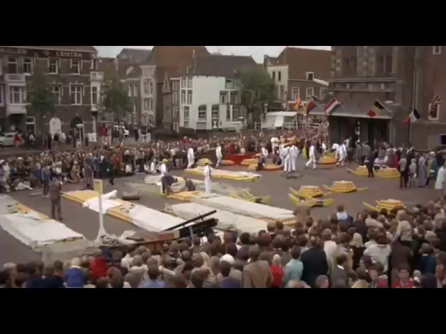 A frame showing the Alkmaar Cheese market, with Edam and Gouda cheeses, taken from the 1969 movie.