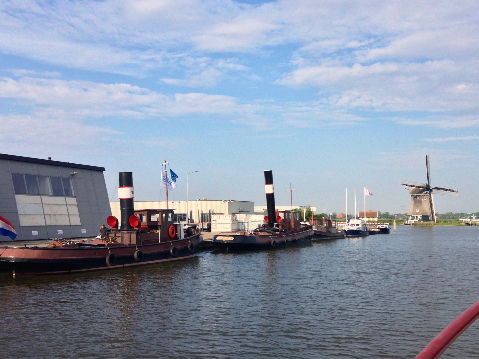 A lovely pair of old tugs, in a typical Dutch setting, obviously having participated in Sail Amsterdam